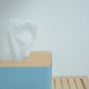 white tissue paper on blue plastic trash bin
