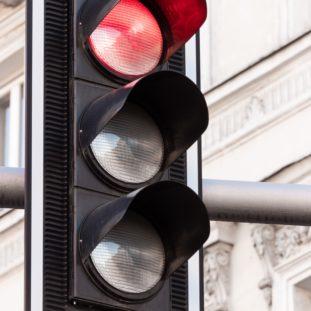 traffic light on stop sign